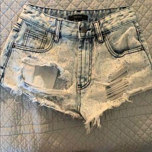 Short ripped denim shorts.